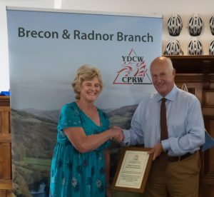Janet Mathews, secretary of Penyrheol Chapel, receiving the certificate of commendation from CPRW Chairman Peter Seaman
