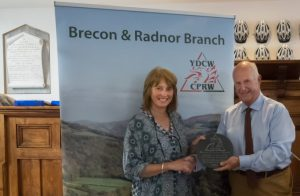 Jane Hughes, owner of Wye Valley Canoes, receiving the Award from CPRW Brecon & Radnor Chairman Peter Seaman